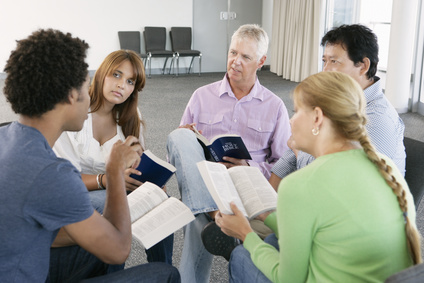 Group of people reading the Bible in a Bible Study group.