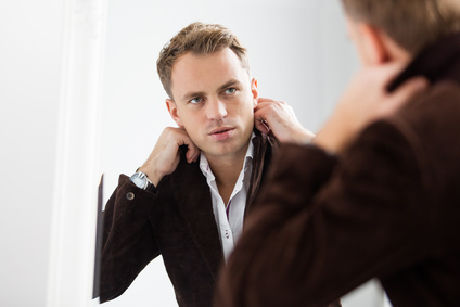 Man looking into mirror wondering about how he identifies with Christ
